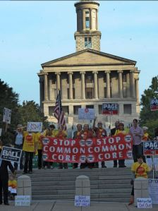 Susan Curlee, upper right holding banner, as pictured on the front page of the Tennessean on Sept. 18.